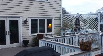 House with rear deck shown before Pergola Installation image