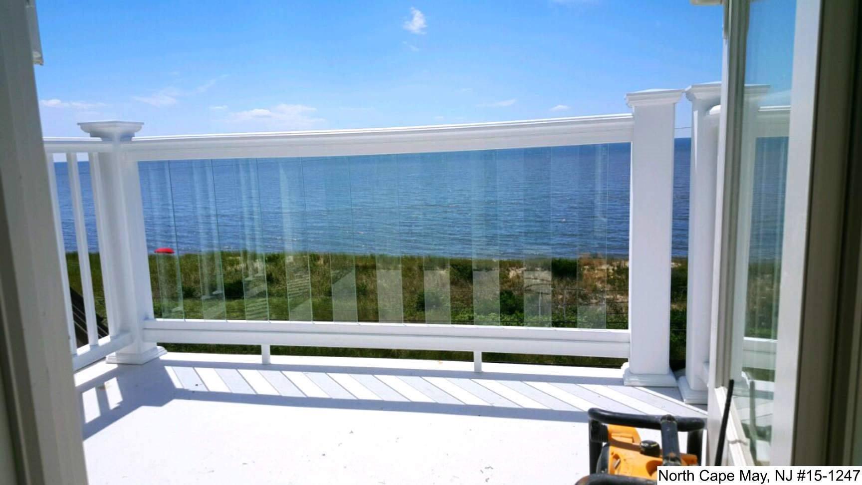 Glass Panel Vinyl Railing installed on a balcony